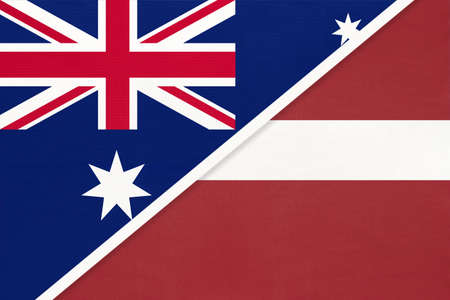 Australia and Latvia, national flags from textile. Relationship, partnership and match between two countries.
