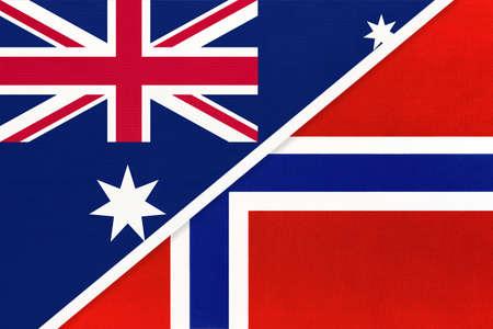 Australia and Norway, national flags from textile. Relationship, partnership and match between two countries. Standard-Bild