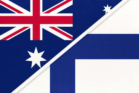 Australia and Finland, national flags from textile. Relationship, partnership and match between two countries.