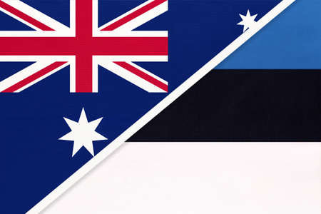 Australia and Estonia, national flags from textile. Relationship, partnership and match between two countries.