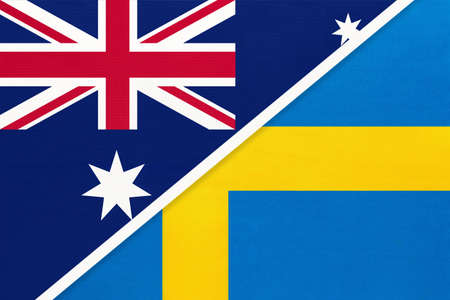Australia and Sweden, national flags from textile. Relationship, partnership and match between two countries.