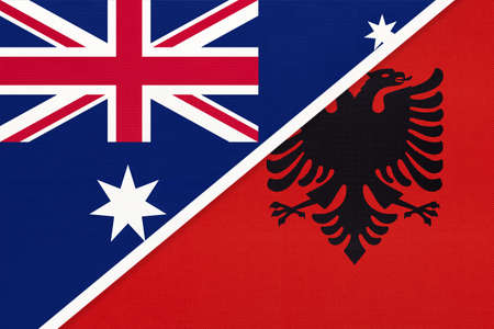 Australia and Albania, national flags from textile. Relationship, partnership and match between two countries.