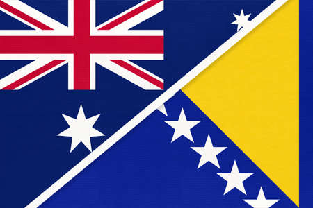 Australia and Bosnia and Herzegovina, national flags from textile. Relationship, partnership and match between two countries.
