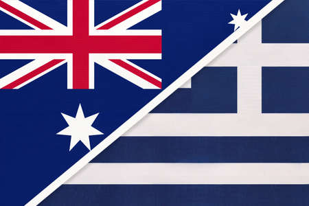 Australia and Greece or Hellenic Republic, national flags from textile. Relationship, partnership and match between two countries.