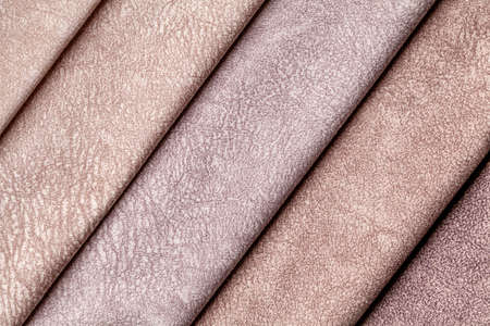 Swatch of velvet textile brown shade colors, background. Catalog and palette tone of Interior fabric for furniture, closeup. Collection of multicolored cloth.
