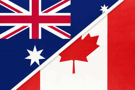Australia and Canada, national flags from textile. Relationship, partnership and match between two countries. 免版税图像