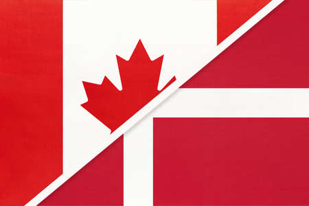 Canada and Denmark, symbol of two national flags from textile. Relationship, partnership and championship between European and American countries. 免版税图像