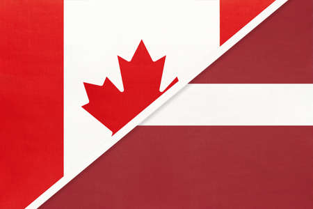 Canada and Latvia, symbol of two national flags from textile. Relationship, partnership and championship between European and American countries.