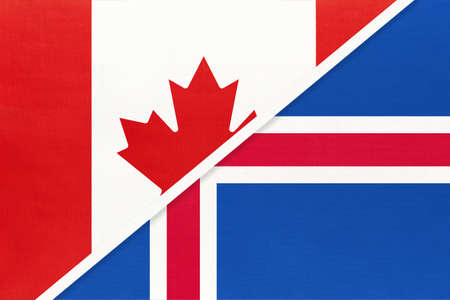 Canada and Iceland, symbol of two national flags from textile. Relationship, partnership and championship between European and American countries. 免版税图像
