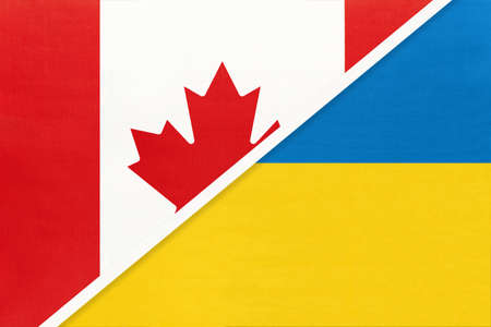 Canada and Ukraine, symbol of two national flags from textile. Relationship, partnership and championship between European and American countries.