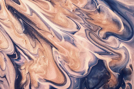 Abstract fluid art background navy blue and beige colors. Liquid marble. Acrylic painting on canvas with golden glitter gradient. Alcohol ink backdrop with shiny wavy pattern.