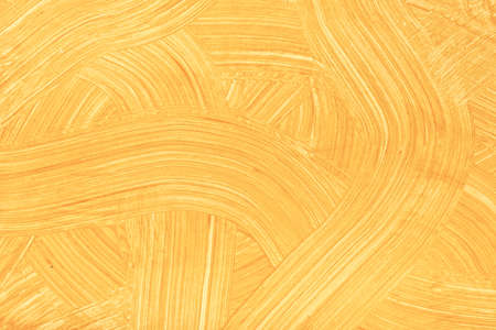 Abstract art background light orange colors. Watercolor painting on canvas with golden strokes and splash. Acrylic artwork on paper with yellow brushstroke curly pattern. Texture backdrop.