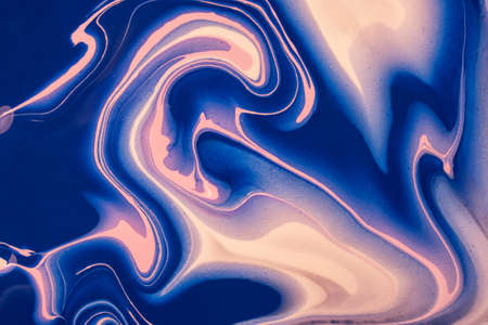 Abstract fluid art background navy blue and pink colors. Liquid marble. Acrylic painting on canvas with sapphire gradient and splash. Alcohol ink backdrop with wavy pattern.