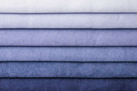 Swatch of woven textile shade and gradient of blue colors, background. Catalog and palette tone of Interior fabric for furniture, closeup. Collection of cloth with wicker pattern. 免版税图像