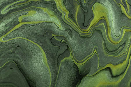 Abstract fluid art background dark green and olive colors. Liquid marble. Acrylic painting on canvas with khaki lines and gradient. Alcohol ink backdrop with wavy pattern.