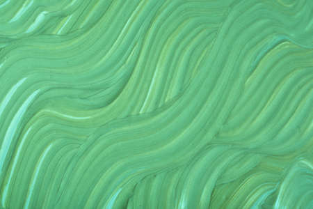 Abstract fluid art background light green colors. Liquid marble. Acrylic painting on canvas with olive gradient. Watercolor backdrop with wavy pattern. Tonal cream.