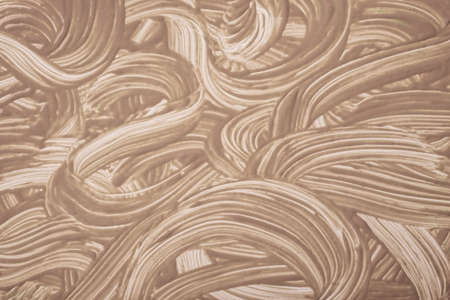 Abstract art background dark brown and beige colors. Watercolor painting on canvas with strokes and splash. Acrylic artwork on paper with brushstroke curly pattern. Texture backdrop.