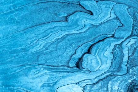 Abstract fluid art pattern light blue and black colors. Liquid marble.