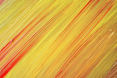 Abstract art background yellow and red colors. Watercolor painting on canvas with golden strokes and splash. Acrylic artwork on paper with spotted pattern. Texture backdrop.