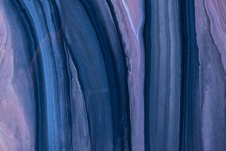 Abstract fluid art background navy blue and purple colors. Liquid marble. Acrylic painting on canvas with violet gradient. Watercolor backdrop with wavy pattern. Stone section.