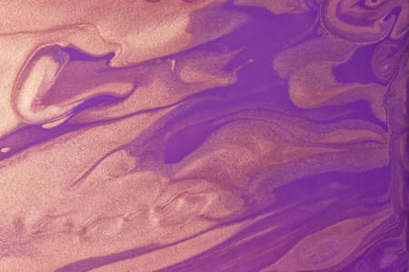 Abstract fluid art background dark purple and golden colors. Liquid marble. Acrylic painting on canvas with violet gradient. Alcohol ink backdrop with wavy pattern.