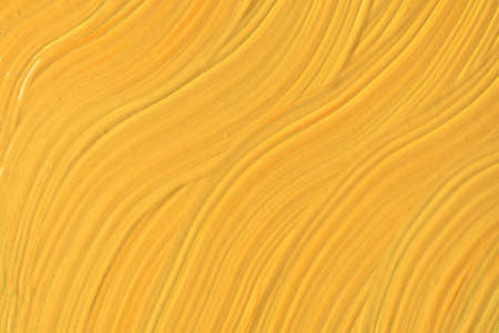 Abstract fluid art background dark yellow colors. Liquid marble. Acrylic painting on canvas with golden gradient. Watercolor backdrop with wavy pattern. Archivio Fotografico