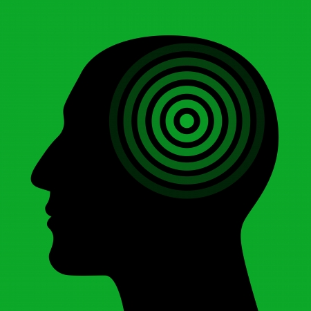 the energy center: Silhouette of a human head wit the target