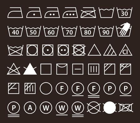 lavadora con ropa: Conjunto de símbolos de lavado de lavandería (iconos) sobre fondo oscuro
