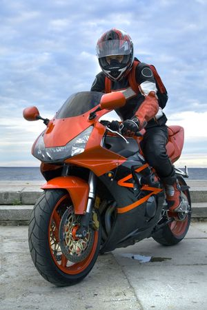 Motocyclist with motocycle