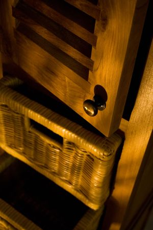 Detail of wooden furniture with drawers photo