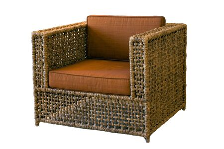 Comfortable rattan armchair on white background