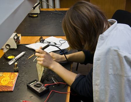 Student at the lesson in technical college photo