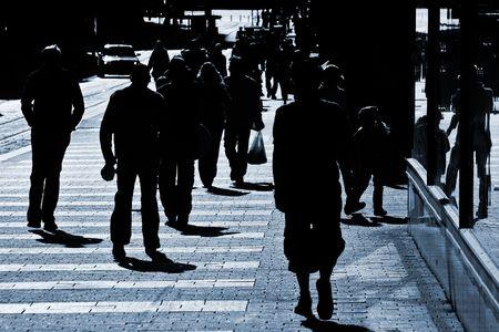 People crowd walking through the street Stock Photo