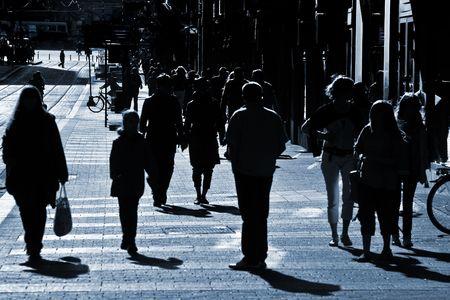 People crowd walking through the street Stok Fotoğraf