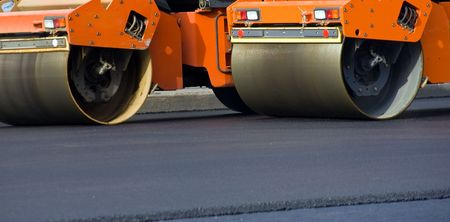 Road roller repairing asphalt pavement photo