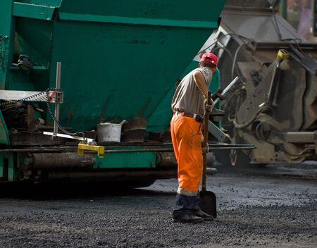 Road workers at the asphalt repairing works