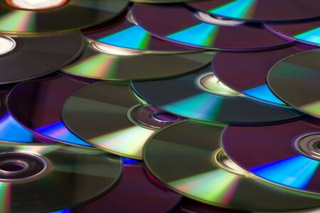 A lot of compact disks - background Stock Photo