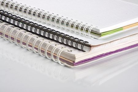 Three school notebooks with spiral binding Stock Photo - 4649953
