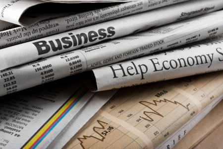 business news: The big stack of old business newspapers
