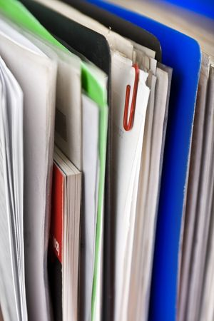 Stack of papers, documents and file folders