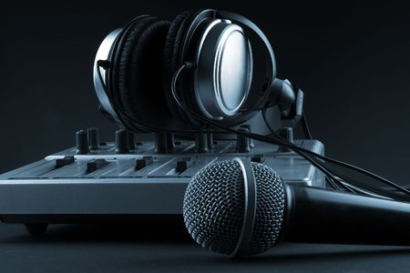 music production: Microphone with mixer and headphones - music studio set