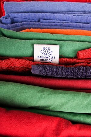 Stack of color textile clothes with label photo