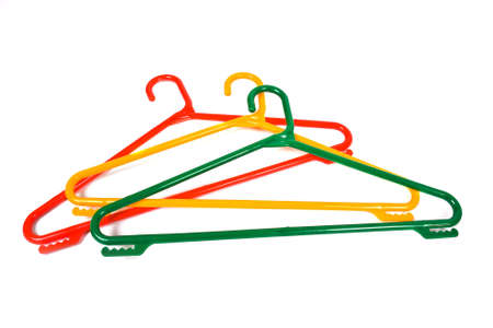 clotheshanger: Colored plastic clotheshangers isolated on white background