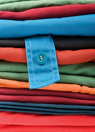 Stack of color clothes stored in rows Stock Photo - 4798242