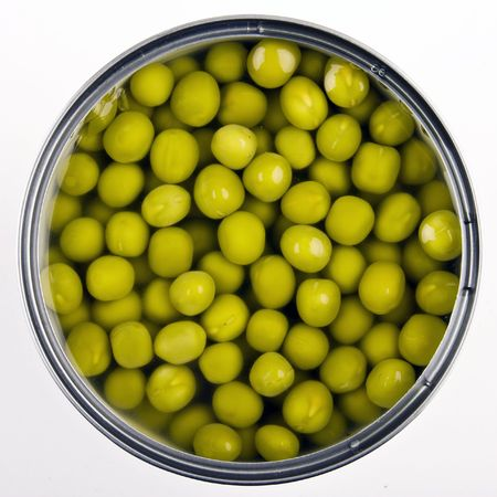 canned food: Canned green peas isolated on white background Stock Photo