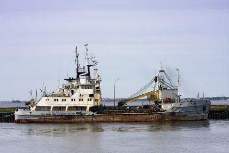 scrap trade: Old rusty trade ship at the harbor of Oranienbaum, Russia Stock Photo
