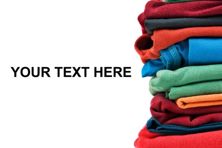 Stack of color clothes stored in rows Standard-Bild