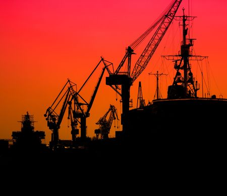 sea port: Silhouette of sea port cranes in the morning, St.Petersburg, Russia Stock Photo