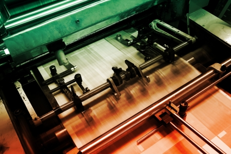 publish: Offset press machine in printing house Stock Photo