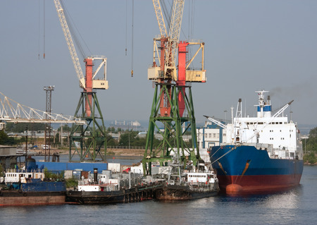 merchant: View of sea port with ships and cranes, St.Petersburg, Russia Stock Photo